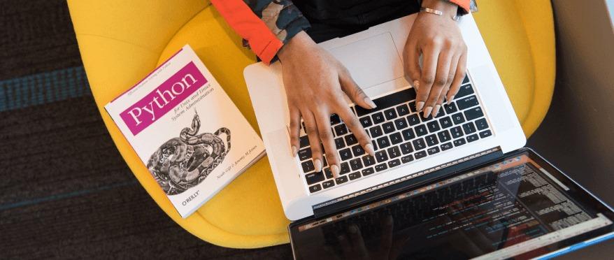 online-flex-bootcamp-student-coding-on-laptop